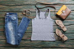 Gray top and blue jeans. Stock Photography