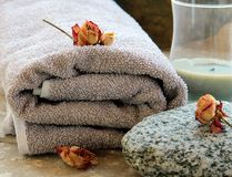 Gray towel with a rock Royalty Free Stock Image