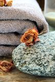 Gray towel with a rock Royalty Free Stock Images