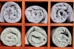Gray towels in the closet Royalty Free Stock Images