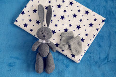 Gray toy rabbit lies Stock Photo