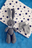 Gray toy rabbit lies Stock Photography