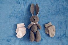 Gray toy rabbit lies Royalty Free Stock Photos