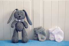 Gray toy rabbit standing Stock Image