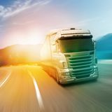 Gray truck on highway. Road in sunlights Royalty Free Stock Photography