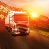 Gray truck on highway. Road at sunset Royalty Free Stock Images