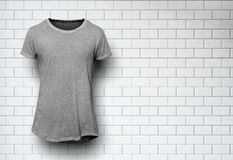 Gray tshirt isolated and wall of the bricks Stock Image