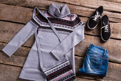 Gray tunic with blue jeans. Stock Photo