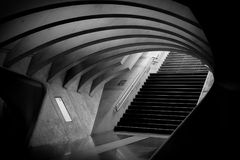 Gray Tunnel and Black Stairs Royalty Free Stock Image