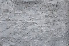 Gray uneven rough concrete wall texture for background and patte Stock Photo
