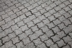 Gray urban cobblestone road Royalty Free Stock Photography