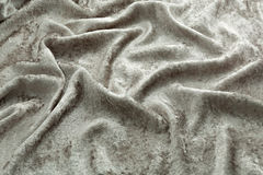 Gray velvet close-up. Fabric macro for texture and background. Gray silk velvet close-up. Fabric macro for texture and background Stock Images