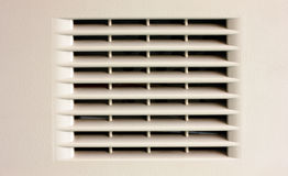 Gray ventilation grille. Gray plastic ventilation grille closeup view Royalty Free Stock Photography