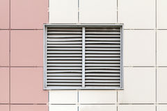 Gray ventilation grille on the window Stock Photos