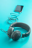 Gray vintage headphones and cellphone. Royalty Free Stock Images