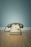 Gray vintage phone on the floor Royalty Free Stock Photography