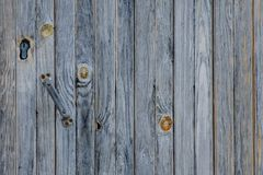Gray vintage planks with handle and keyhole. Vertically arranged. Texture. Background Royalty Free Stock Photography