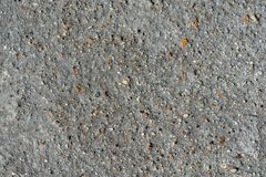 Gray volcanic sand, small colorful stone surface stock photo