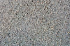 Gray volcanic sand and small stone surface. Detailed natural background or texture royalty free stock photography