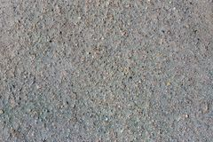 Gray volcanic sand, small stone surface, natural background or texture stock photography