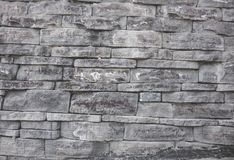 Gray wall background of uneven brickwork stone texture royalty free stock photo