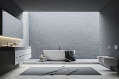 Gray bathroom interior. Gray wall bathroom interior with a white tub, a double sink and a long mirror above it. Toilets. 3d rendering mock up Royalty Free Stock Image