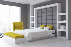 Gray wall bedroom, side. Side view of a gray wall bedroom with a panoramic window and a yellow armchair standing beside a double bed. 3d rendering Stock Image