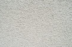 Gray wall closeup uneven granular cement coating Royalty Free Stock Photo