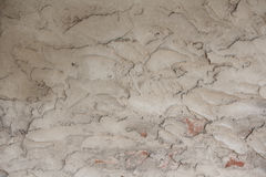 Gray wall covered with plaster. Rough texture Stock Images