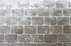 Gray wall covered with snow Royalty Free Stock Images