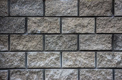 Gray wall of granite bricks texture Stock Photography