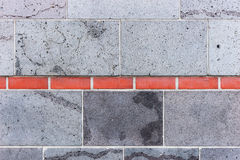 Gray wall, interrupted by red bricks. Wall background Stock Photo