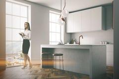 Gray wall kitchen corner, black countertops Royalty Free Stock Photo