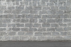 Gray wall made of concrete blocks Stock Image