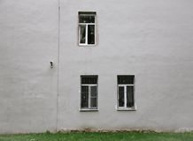 Gray wall with three windows Stock Photos