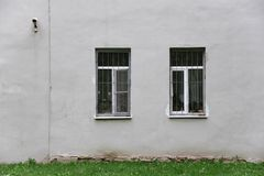 Gray wall with two windows Royalty Free Stock Photo