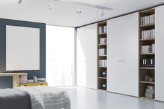 Gray walled bedroom with bookcase Stock Photography
