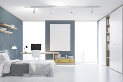 Gray walled bedroom with study corner, front Royalty Free Stock Photo