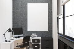 Gray walled office with poster, close up Stock Photography