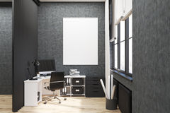 Gray walled office with poster Royalty Free Stock Photo