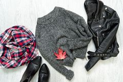 Gray warm sweater. Black jacket, checkered scarf and boots. Fashionable concept Stock Photo