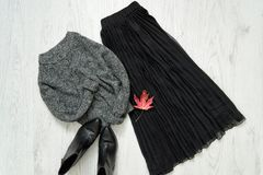 Gray warm sweater, black skirt and boots. Fashionable concept.  stock photography