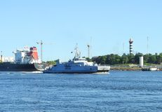 Warship coming in Klaipeda town, Lithuania Stock Photo
