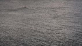 Gray water and small boat. Sea, river, calm, cold. Gray water and small boat stock video footage
