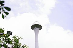 Water supply tank and clouds stock images
