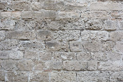 Gray, weathered stone blocks wall background Royalty Free Stock Images