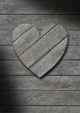 Gray weathered wood heart on wooden background Royalty Free Stock Photography