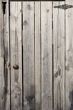 Weathered wooden door with hinge Royalty Free Stock Photo