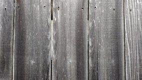 Gray Weathered Wooden Fence voor Achtergrond of Behang Stock Afbeelding