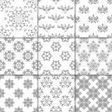 Gray and white floral ornaments. Collection of seamless patterns Stock Images